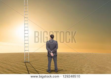 Rear view of classy businessman posing against desert scene