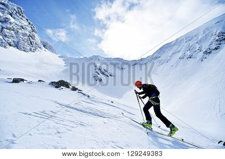 FAGARAS ROMANIA - MARCH 5: Ski mountaineer competes during the Ski Mountaineering National Competition in Fagaras Mountains Carpathian Range on March 5 2016 in Romania.