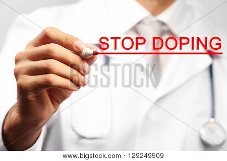 Stop doping concept. Doctor with pen closeup