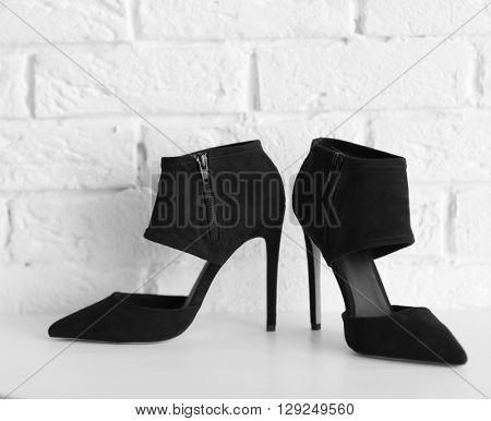 Black woman high heels on a brick wall background