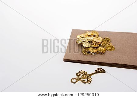 Fake gold coins key and box on white background