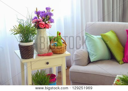 Easter composition with eggs and plants in living room