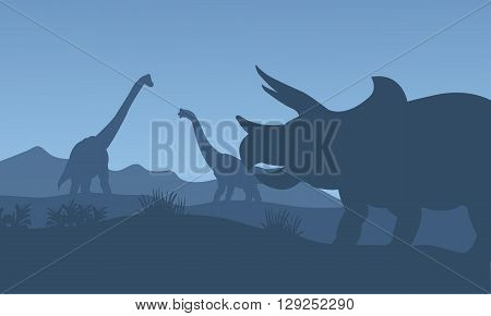 Silhouette triceratops and Brachiosaurus with blue backgrounds
