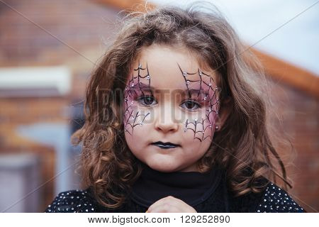 Lovely Little Girl Looking At Camera In Halloween