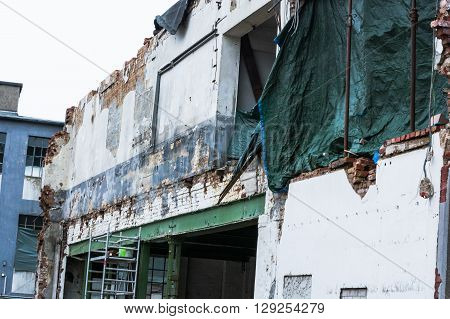 Demolition of a building in urban environments. House in ruins.