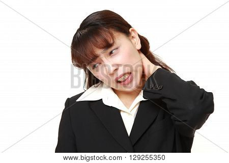 portrait of Asian businesswoman suffers from neck ache on white background