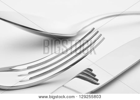 Knife fork spoon detail over a white background. Cutlery. Horizontal