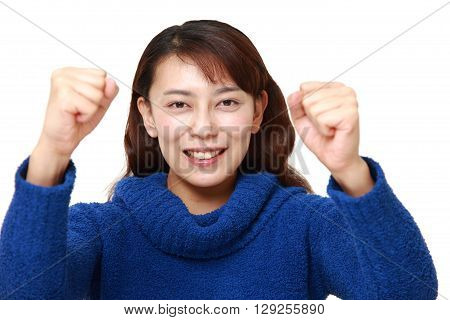 portrait of Asian woman in a victory pose on white background