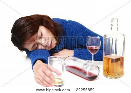 Asian woman in depression is drinking alcohol