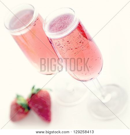 Pink champagne with strawberries and creamy vintage editing