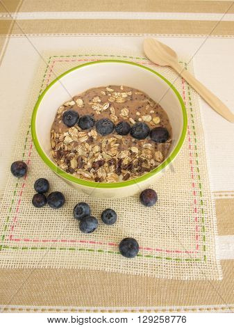 Smoothie bowl with muesli, blueberries and cocoa nibs