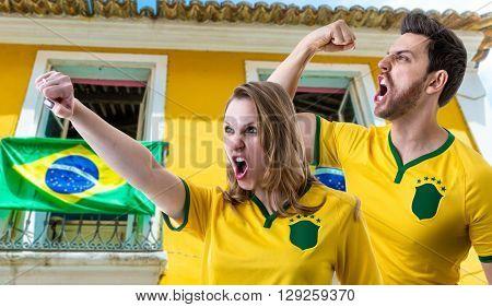 Brazilian couple fans celebrating in the street
