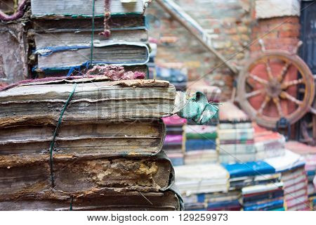 a lot of the old torn and shabby books closeup and an indistinct background