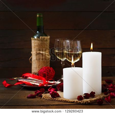 Romantic Dinner Setting, Candles, Wine And Decor