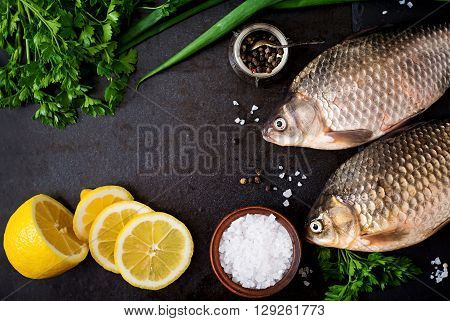 Two Fresh Raw Crucian On A Wooden Background With Herbs. Top View