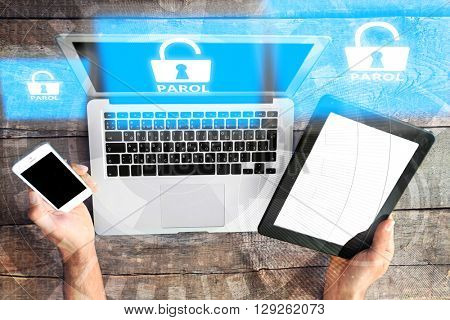 Laptop and table-pc, smartphone with icons security on virtual display. Technology, internet and networking concept.