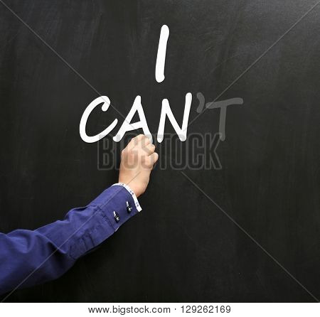 Hand writing words I cant transformed into I can on blackboard