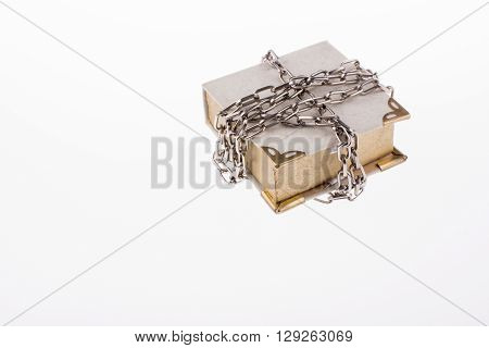 A chained book on a white background