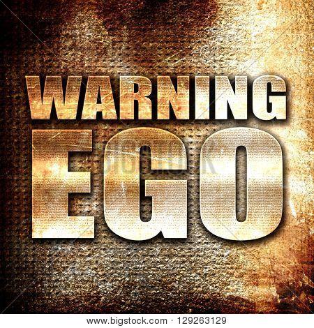 warning ego, rust writing on a grunge background