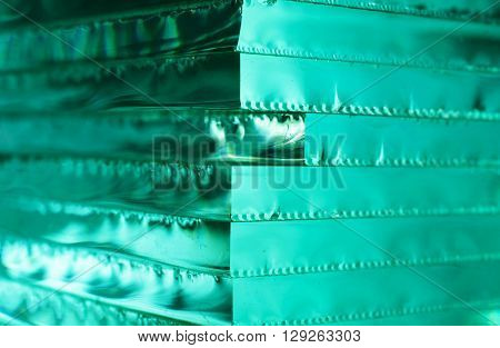 Glass texture. Abstract background with stack of glass sheets. luminous texture. side corner view