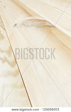The light beige plank. The wood texture. The background. The diagonal plank.