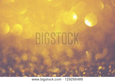 Golden defocused composition with bokeh circle lights