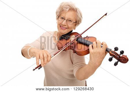 Mature woman playing violin and looking at the camera isolated on white background