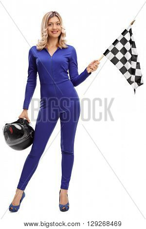 Full length portrait of a racing woman holding a checkered race flag and a helmet isolated on white background