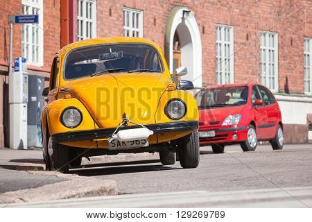 Old Yellow Volkswagen Beetle Is Parked