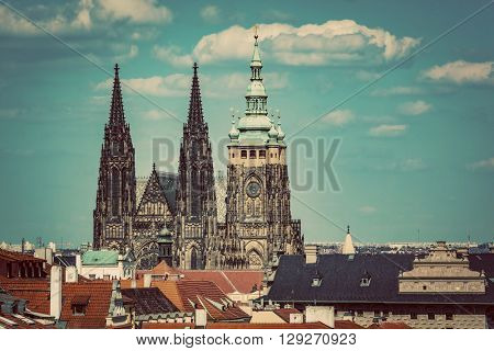 St. Vitus Cathedral, Prague, Czech Republic over old town red roofs. Vintage