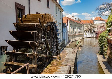 Historic water mill on Kampa Island in Prague, Czech Republic. Branch of the Vltava river, the Certovka or Devil's Stream