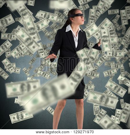 Blindfolded businesswoman with hands out against blue background