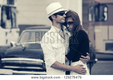Happy young couple in love. Male and female fashion model outdoor. Young man and woman on city street