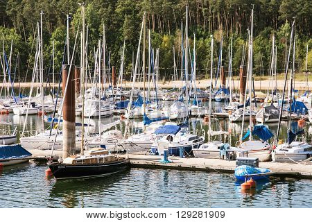 Sailboats at the pier in Brombachsee Germany. Summer vacation. Travel destination. Beautiful place.