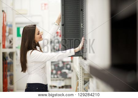 young brunette woman working in hardware store