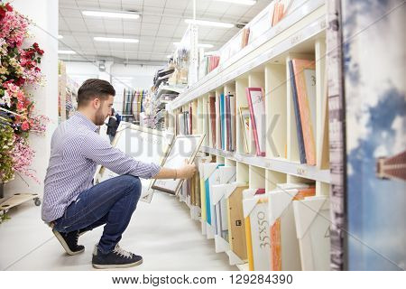 young caucasian man working  in hardware store