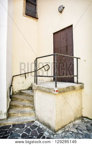 Old iron gate with railing and staircase to the church. Trencin Slovak republic. Religious architecture. Architectural element.