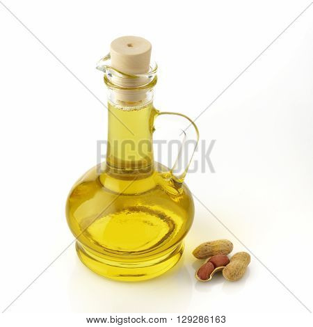 Ground nut oil shot in studio on white background