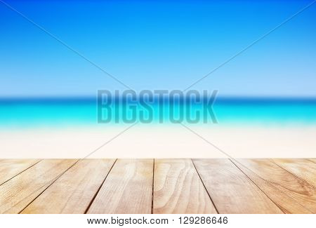 Wooden Table On Blue Sea And White Sand Beach