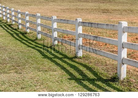 The white fence in agriculture farm land.