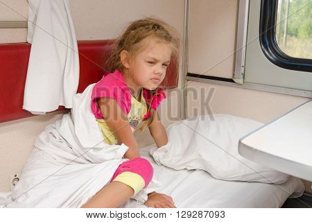 The Girl On The Train Sleepily Gets Out Of Bed On The Lower Place In The Second-class Compartment Wa