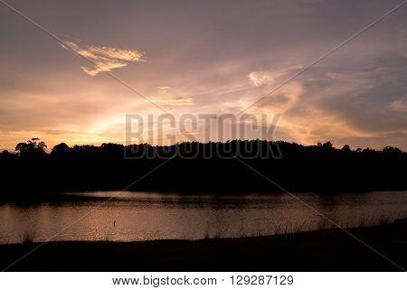 Beautiful sky landscape with sunset over river bank