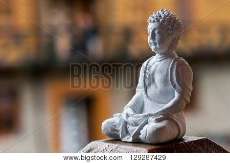 Buddha ceramic statue.  Yoga, buddhism, meditation background with empty space for text.