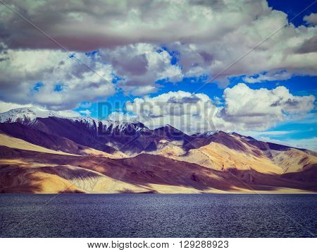 Vintage retro effect filtered hipster style image of Himalayan mountain lake in Himalayas Tso Moriri on sunset, Korzok, Ladakh, India
