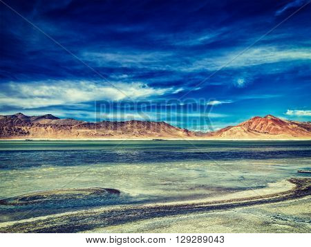 Vintage retro effect filtered hipster style image of Tso Kar - fluctuating salt lake in Himalayas. Rapshu,  Ladakh, Jammu and Kashmir, India