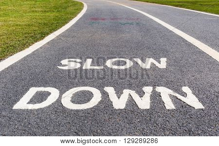 The warning sign to slow down marked on street safety concept.