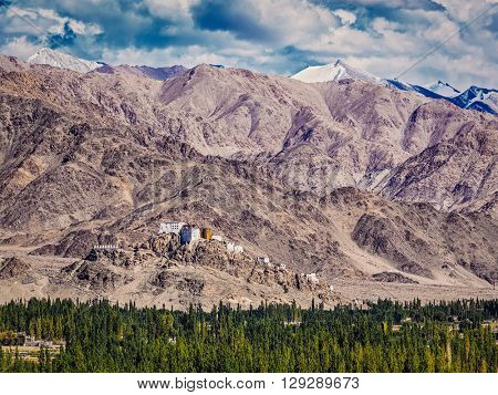 Vintage retro effect filtered hipster style image of Thiksey gompa and Himalayas. Ladakh, Jammu and Kashmir, India
