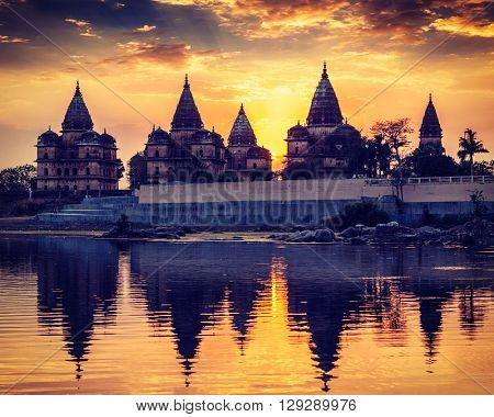 Vintage retro effect filtered hipster style image of Royal cenotaphs of Orchha over Betwa river. Orchha, Madhya Pradesh, India