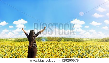 Rare View Of Women Raise Arms Embrace Sunflowers Field With Nature And Widely Blue Puffy Cloudy Sky