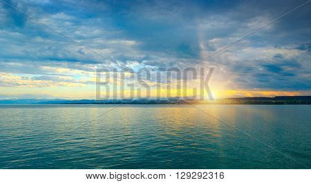 Dawn above sea and blue sky